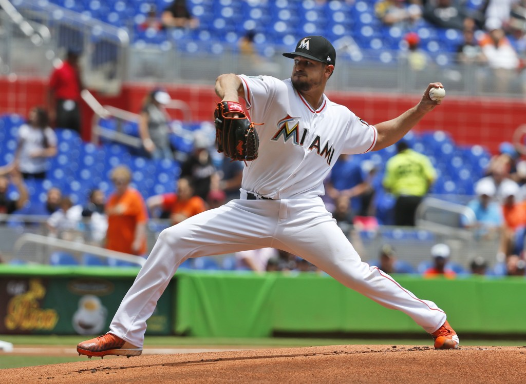 Miami Marlins' Caleb Smith delivers a pitch during the first inning of a baseball game against the Colorado Rockies, Sunday, April 29, 2018, in Miami....