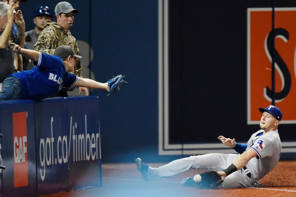 Texas Rangers left fielder Ryan Rua (16) makes a catch on a foul ball off the bat of Toronto Blue Jays shortstop Aledmys Diaz (1) during sixth inning ...