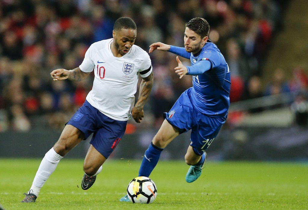FILE - In this Tuesday, March 27, 2018 filer, England's Raheem Sterling, left, and Italy's Jorginho vie for the ball during the international friendly...