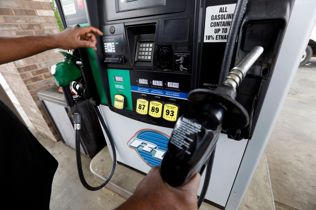 FILE- In this April 23, 2018, file photo a customer prepares to make his selection among the various offerings at the gasoline pump in Richland, Miss....