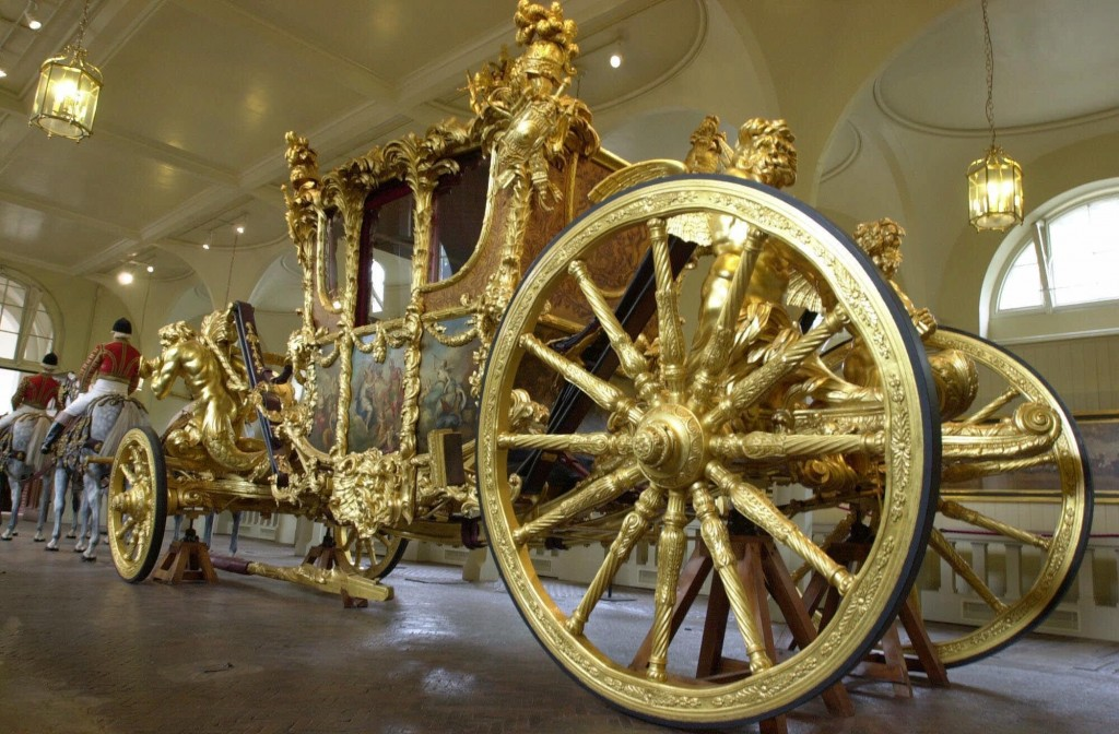 FILE - This June 15, 2001, file photo, shows the Queen's Gold State Coach in the Royal Mews in Buckingham Palace, in London, Fans of the British royal...