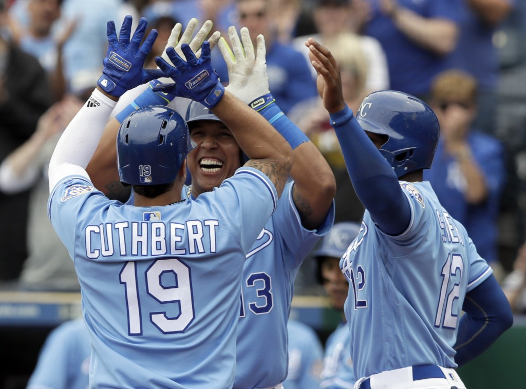 Kansas City Royals' Cheslor Cuthbert (19) celebrates his three-run home run with teammates Salvador Perez (13) and Jorge Soler (12) during the fifth i...