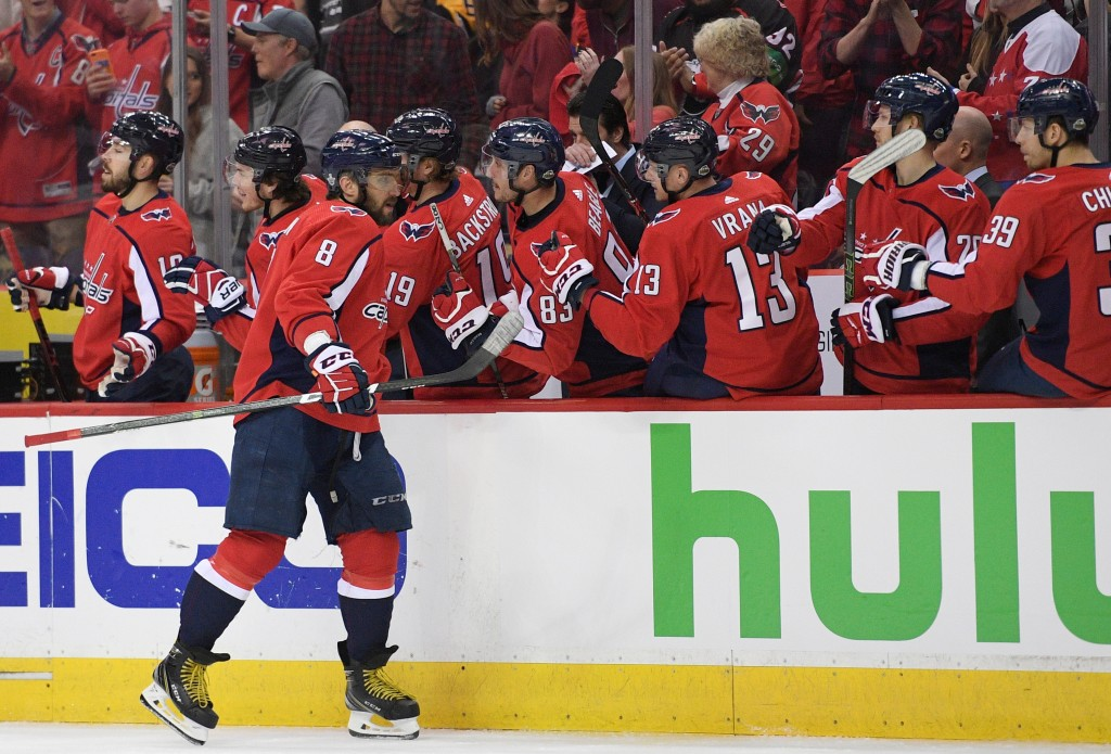 Washington Capitals left wing Alex Ovechkin (8), of Russia, celebrates his goal with the bench during the first period in Game 2 of an NHL second-roun...