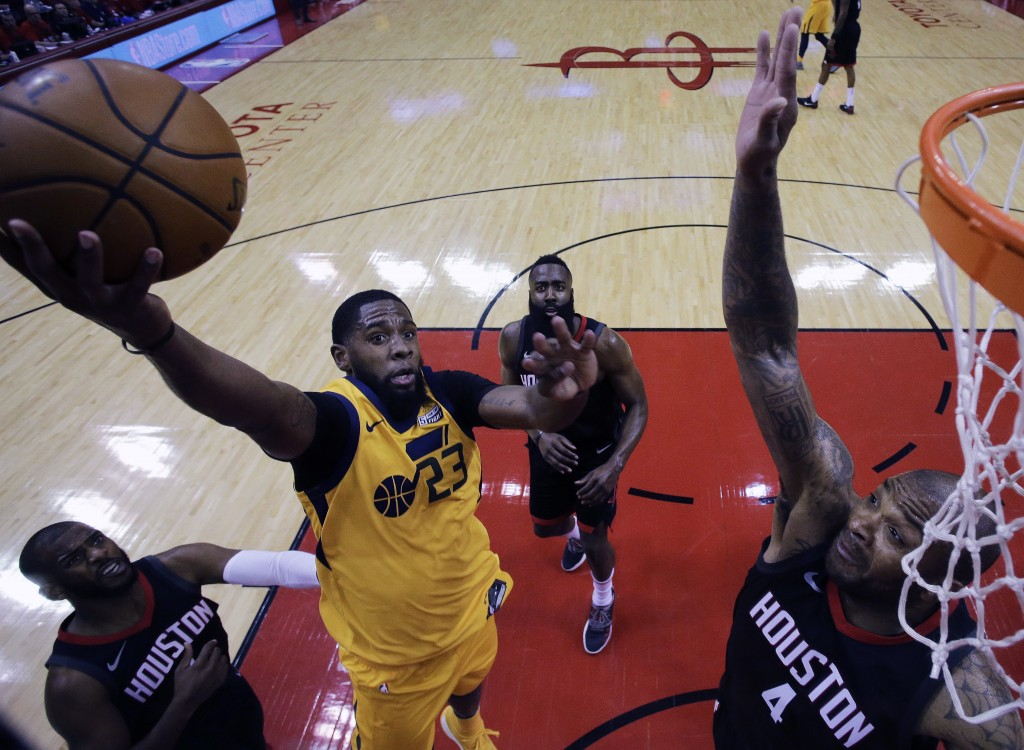 Utah Jazz forward Royce O'Neale (23) drives to the basket as Houston Rockets forward PJ Tucker (4) defends during the first half in Game 1 of an NBA b...