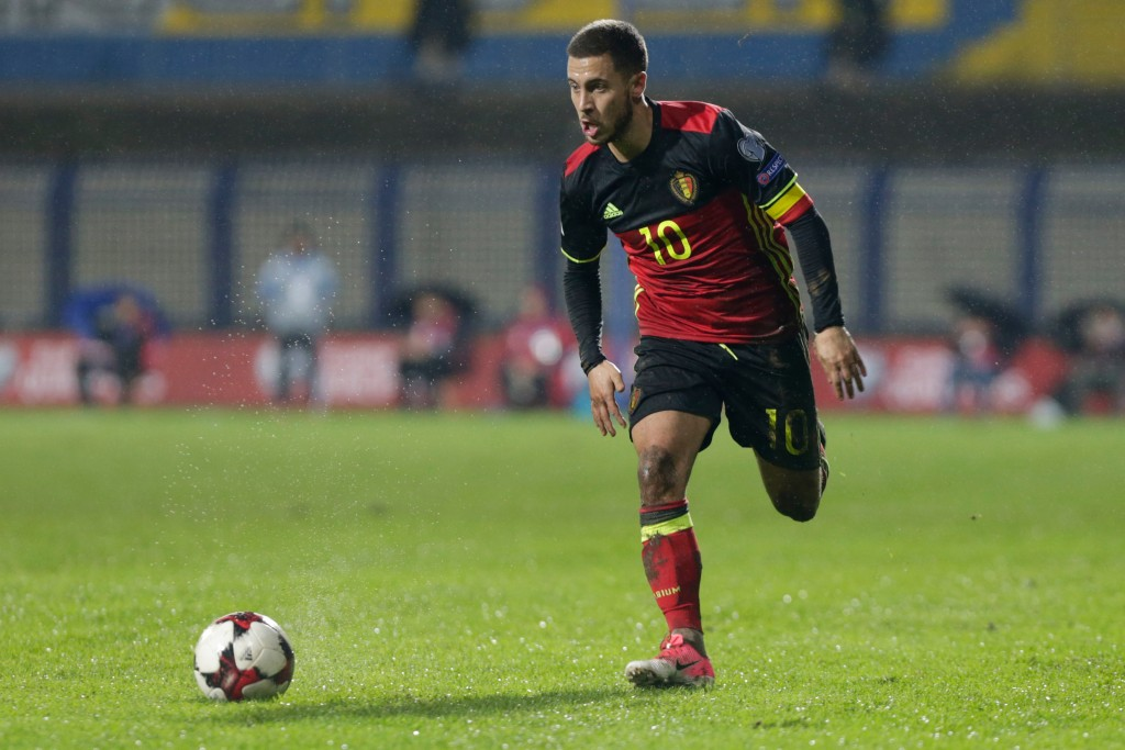 FILE - In this Saturday, Oct. 7, 2017 filer , Belgium's Eden Hazard controls the ball during the World Cup Group H qualifying soccer match between Bos...