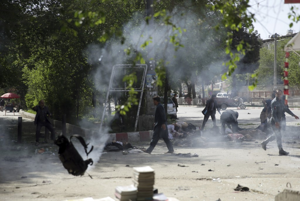 Victims in double explosions lie on the ground in Kabul, Afghanistan, Monday, April 30, 2018. The explosions targeted central Kabul on Monday morning,...