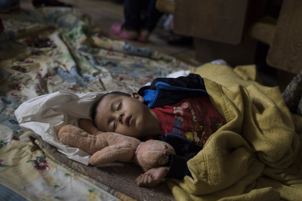 A Central American child who is traveling with a caravan of migrants sleeps at a shelter in Tijuana, Mexico, Sunday, April 29, 2018. U.S. immigration ...