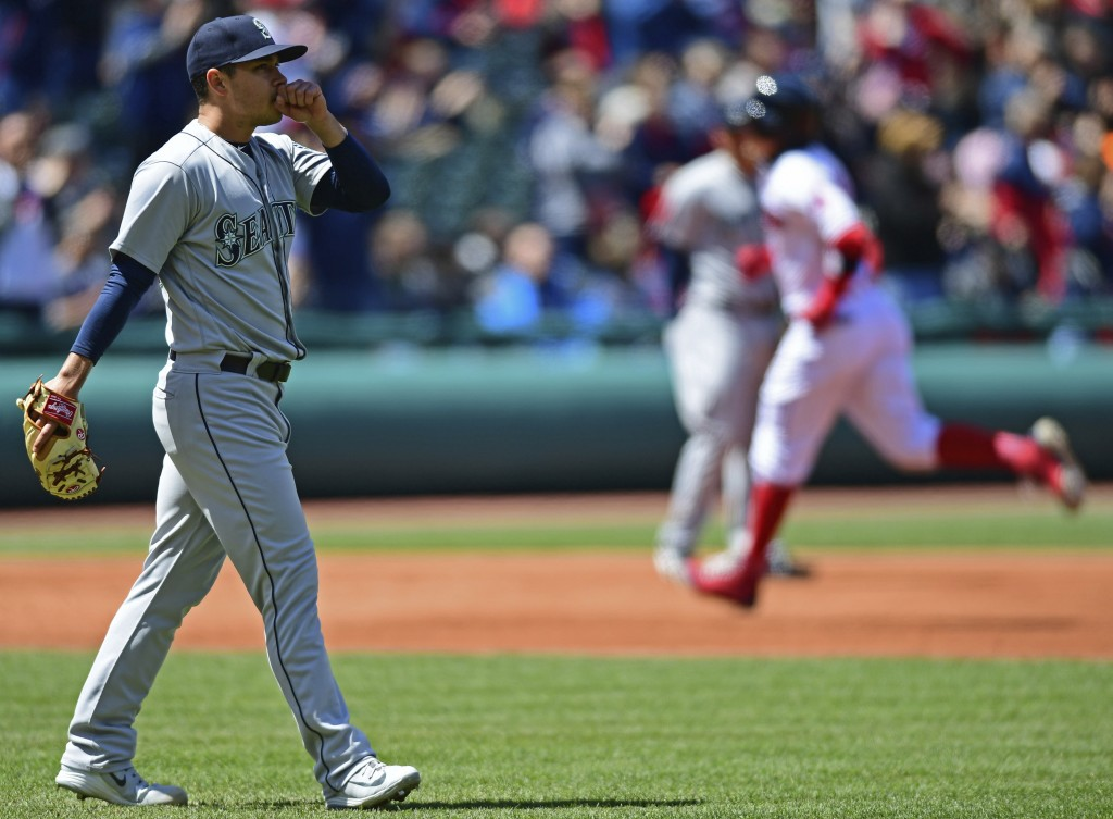 Seattle Mariners starting pitcher Marco Gonzales waits for Cleveland Indians' Brandon Guyer to run the bases after Guyer hit a two-run home run in the...