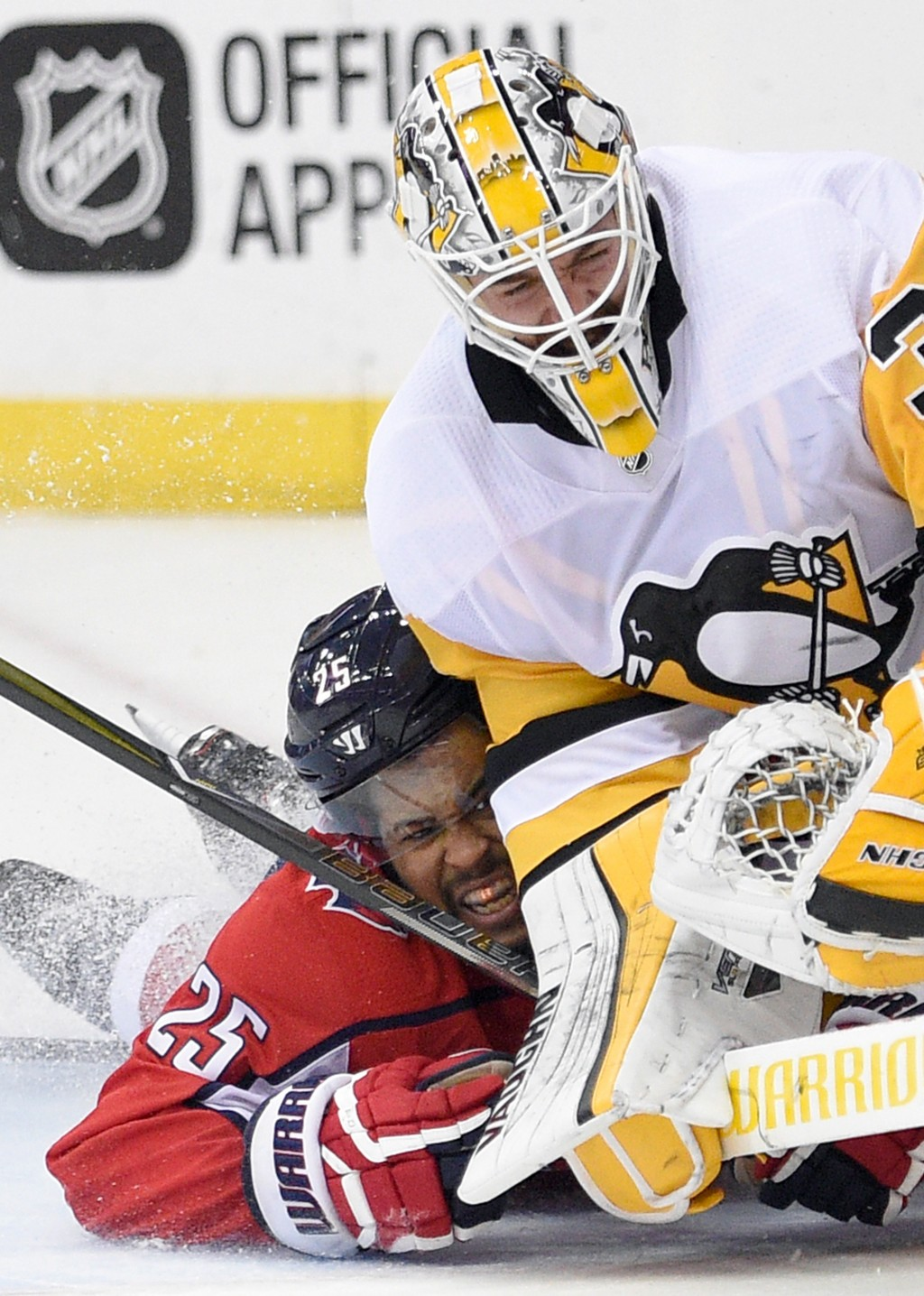 Washington Capitals right wing Devante Smith-Pelly, left, collides into Pittsburgh Penguins goaltender Matt Murray (30) during the second period in Ga...