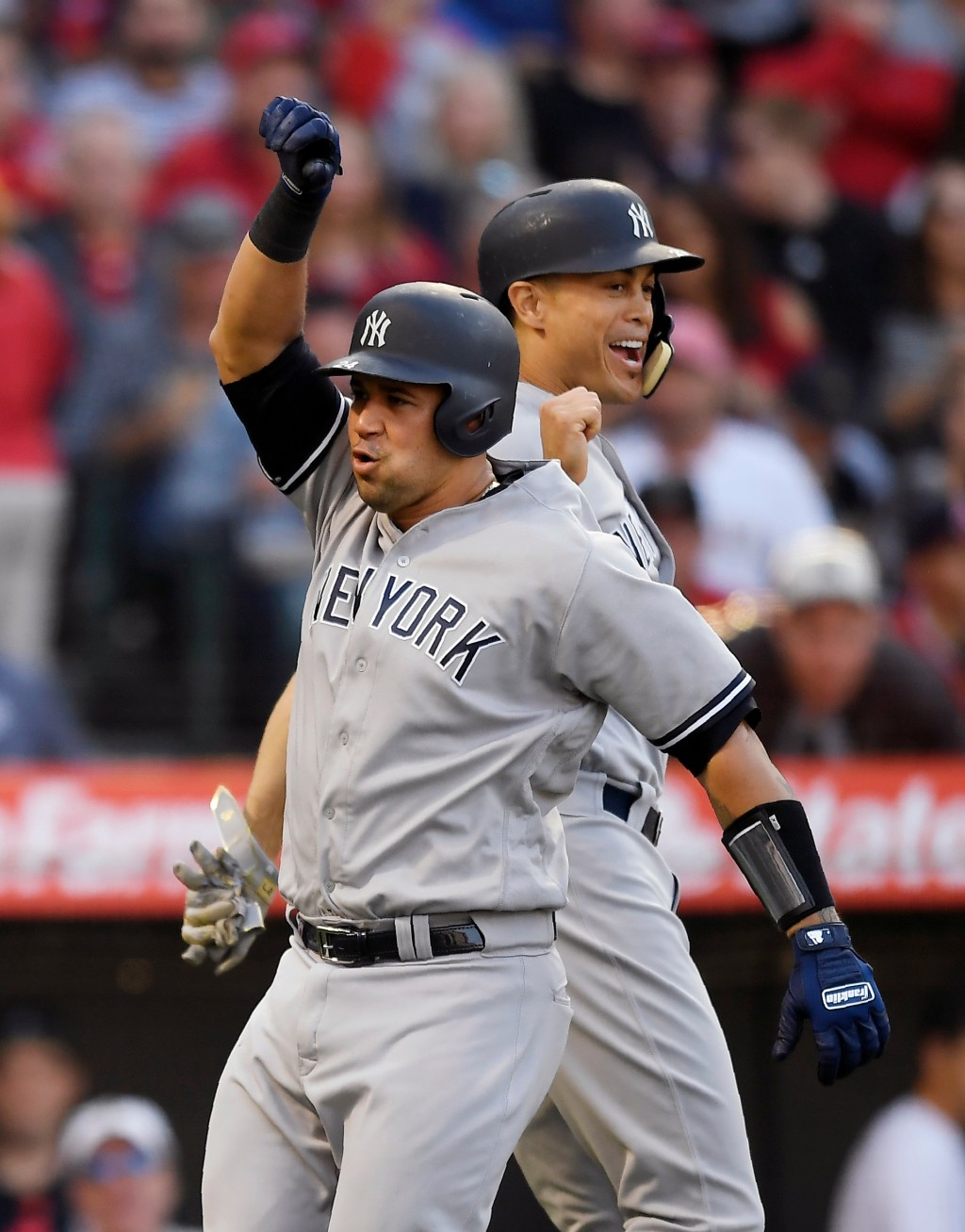 New York Yankees' Gary Sanchez, left, celebrates with Giancarlo Stanton after hitting a two-run home run during the fourth inning of a baseball game a...