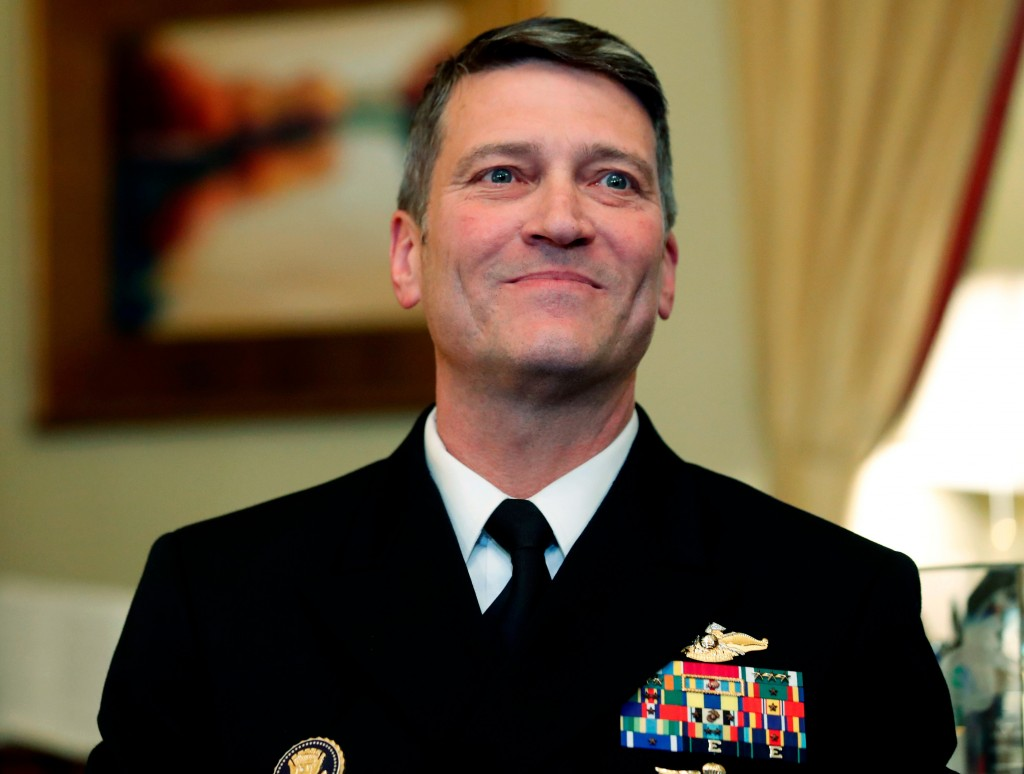 FILE - In this April 16, 2018, file photo, U.S. Navy Rear Adm. Ronny Jackson, M.D., sits before a meeting on Capitol Hill in Washington. Jackson, who ...