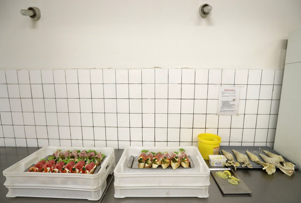 In this picture taken on Thursday, March 1, 2018, open-face sandwiches are prepared at traditional delicatessen Golden Cross in Prague, Czech Republic...