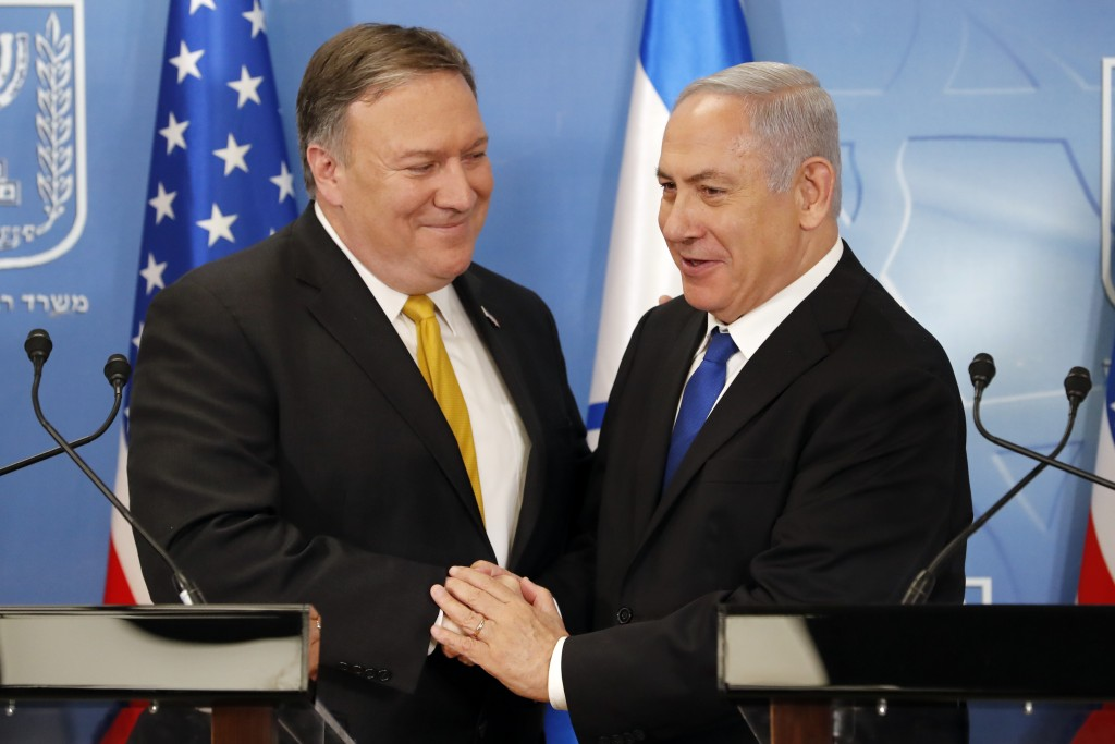 U.S. Secretary of State Mike Pompeo. left. is greeted by Israeli Prime Minister Benjamin Netanyahu ahead of a press conference at the Ministry of Defe...