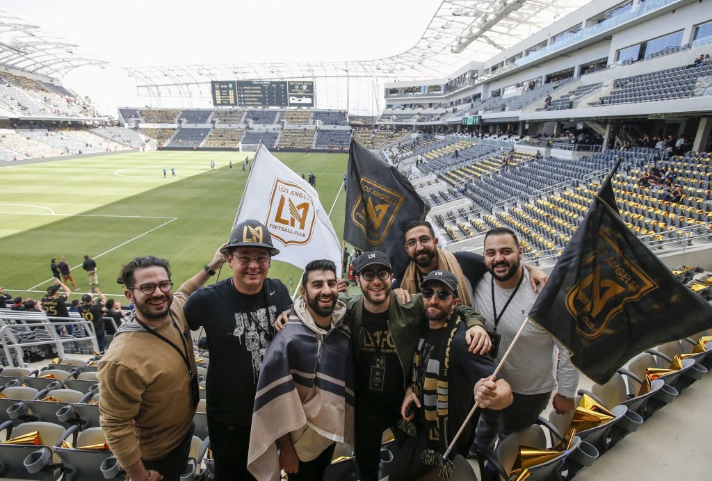Fans of Los Angeles FC pose for photo prior to an MLS soccer game against the Seattle Sounders at the new Banc of California Stadium in Los Angeles, S...