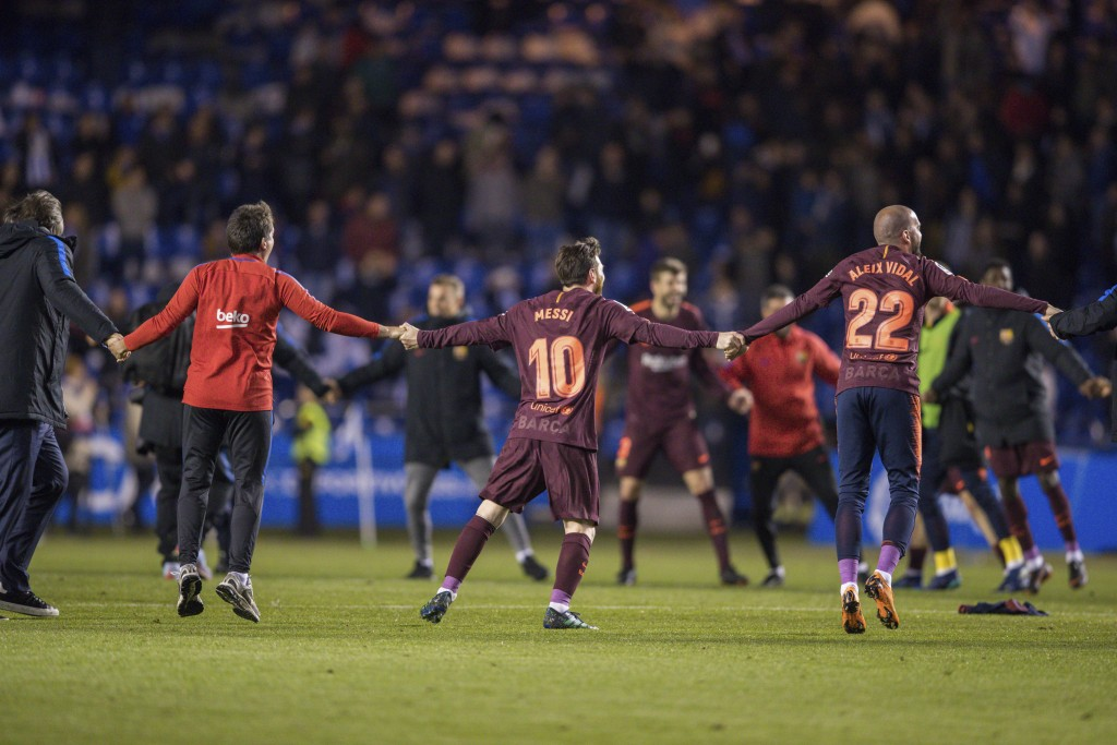 Barcelona's Lionel Messi, center, and teammates celebrate after winning the 2017-18 Spanish La Liga at the end of the soccer match between Deportivo a...