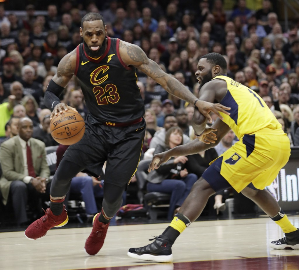 Cleveland Cavaliers' LeBron James, left, drives past Indiana Pacers' Lance Stephenson in the first half of Game 7 of an NBA basketball first-round pla...