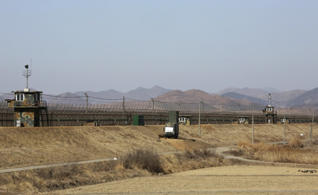 In this Feb. 15, 2018 photo, a South Korean military vehicle with loudspeakers is seen in front of the barbed-wire fence in Paju, near the border with...