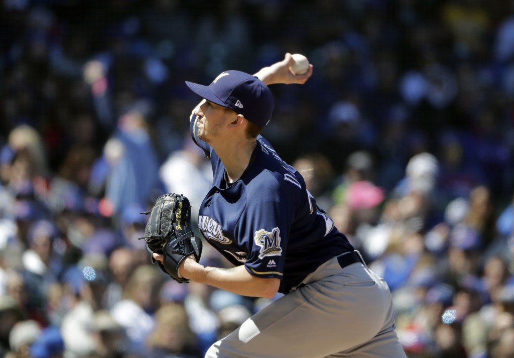 Milwaukee Brewers starting pitcher Zach Davies throws against the Chicago Cubs during the second inning of a baseball game Sunday, April 29, 2018, in ...