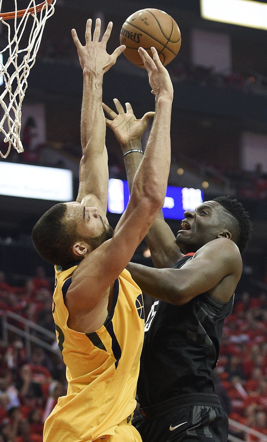 Houston Rockets center Clint Capela, right, shoots as Utah Jazz center Rudy Gobert defends during the first half in Game 1 of an NBA basketball second...