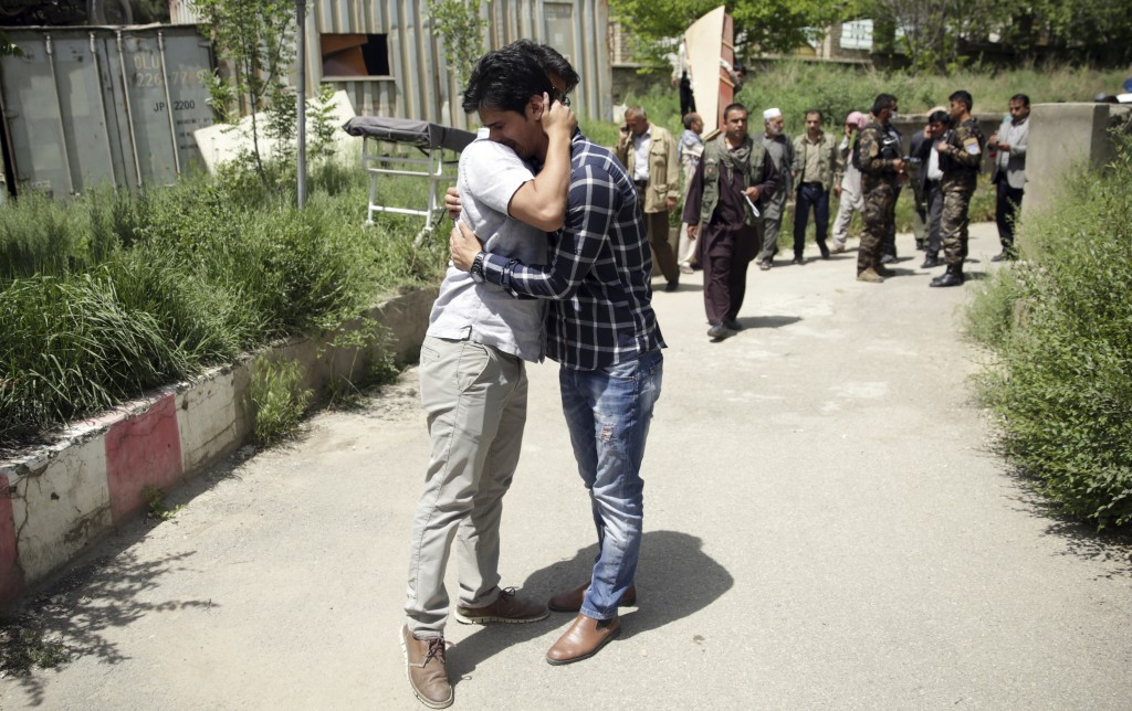 Journalists mourn for their colleagues, who have been killed in the second bombing,  in Kabul, Afghanistan, Monday, April 30, 2018. A coordinated doub...