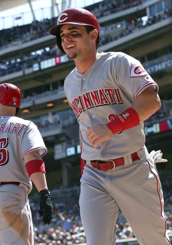 Cincinnati Reds' Scooter Gennett heads to the dugout after scoring on a single by Cincinnati Reds' Scott Schebler off Minnesota Twins' pitcher Matt Ma...