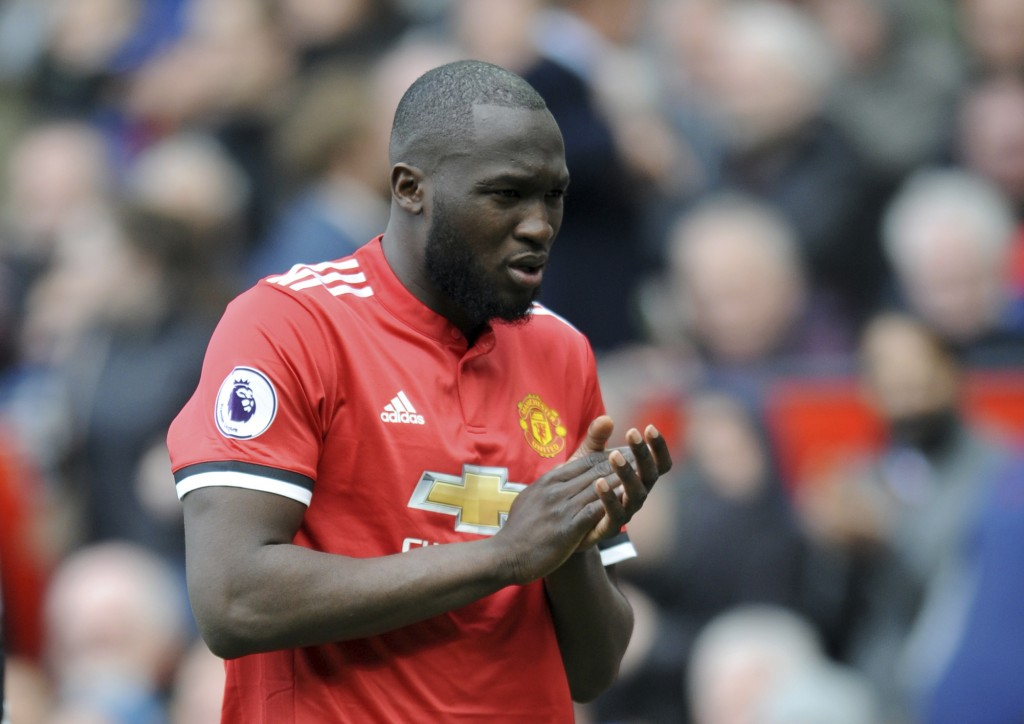 Manchester United's Romelu Lukaku applauds to supporters and leaves the field during the English Premier League soccer match between Manchester United...
