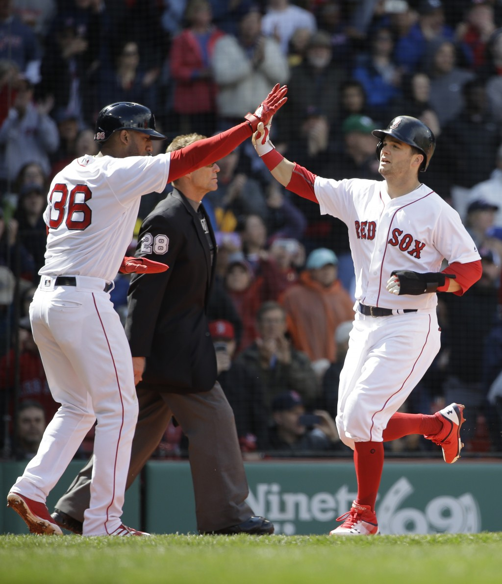 Boston Red Sox's Eduardo Nunez, left, and Andrew Benintendi, right, celebrate at home plate as they score on a single hit by Boston Red Sox right fiel...