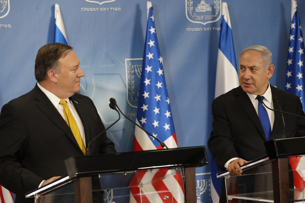 U.S. Secretary of State Mike Pompeo. left. and Israeli Prime Minister Benjamin Netanyahu speak during a a press conference at the Ministry of Defense ...