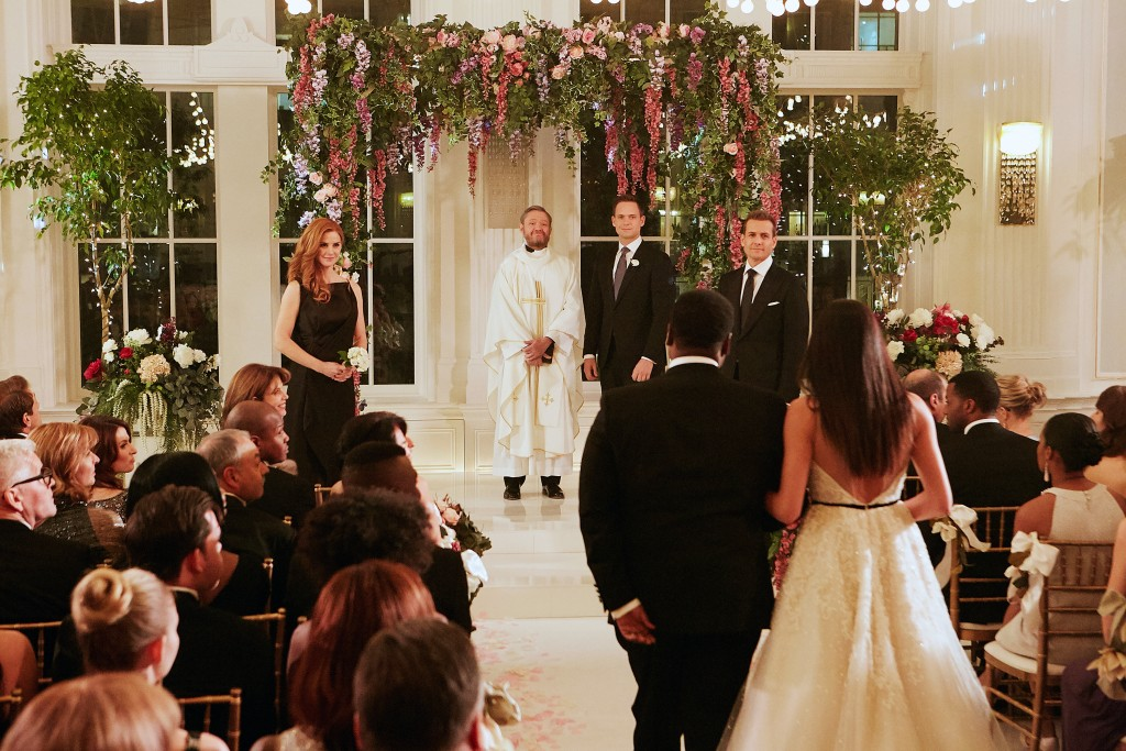 "This image released by USA Network shows a wedding scene from the ""Good-Bye"" episode of ""Suits."" Meghan Markle's character dreams of getting married a..."