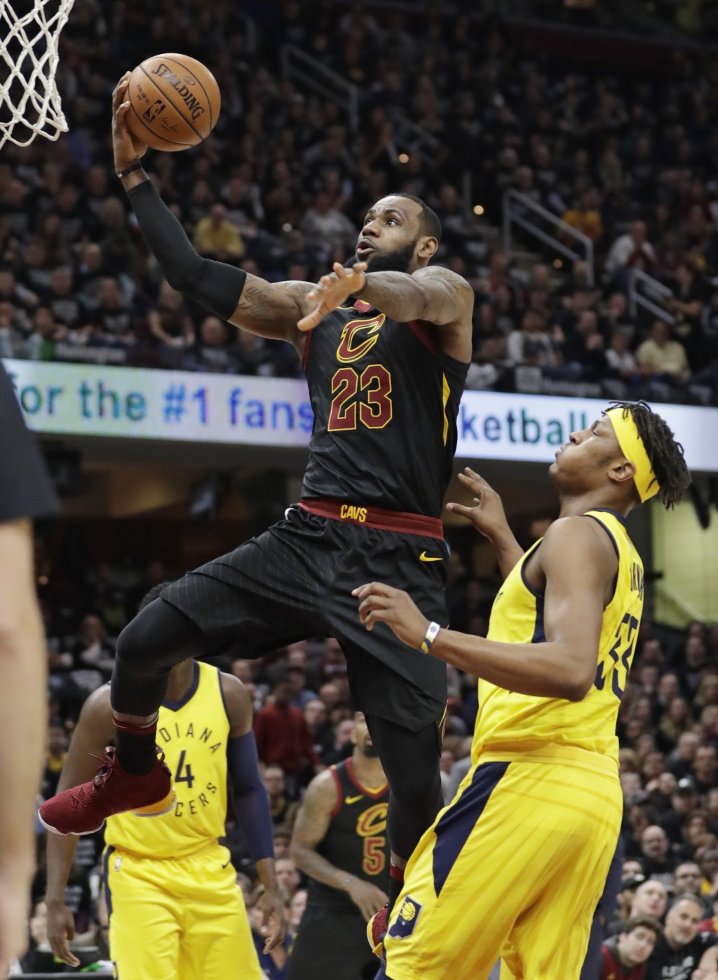 Cleveland Cavaliers' LeBron James (23) drives to the basket against Indiana Pacers' Myles Turner (33) in the first half of Game 7 of an NBA basketball...