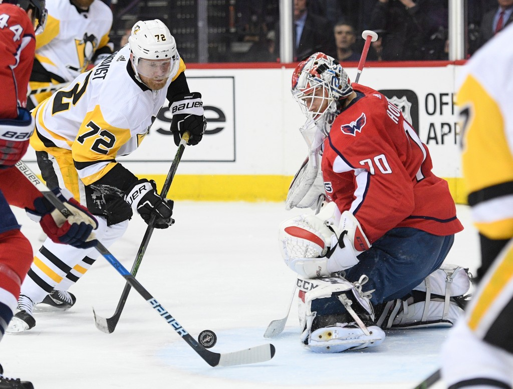 Pittsburgh Penguins right wing Patric Hornqvist (72), of Sweden, chases the puck against Washington Capitals goaltender Braden Holtby (70) during the ...