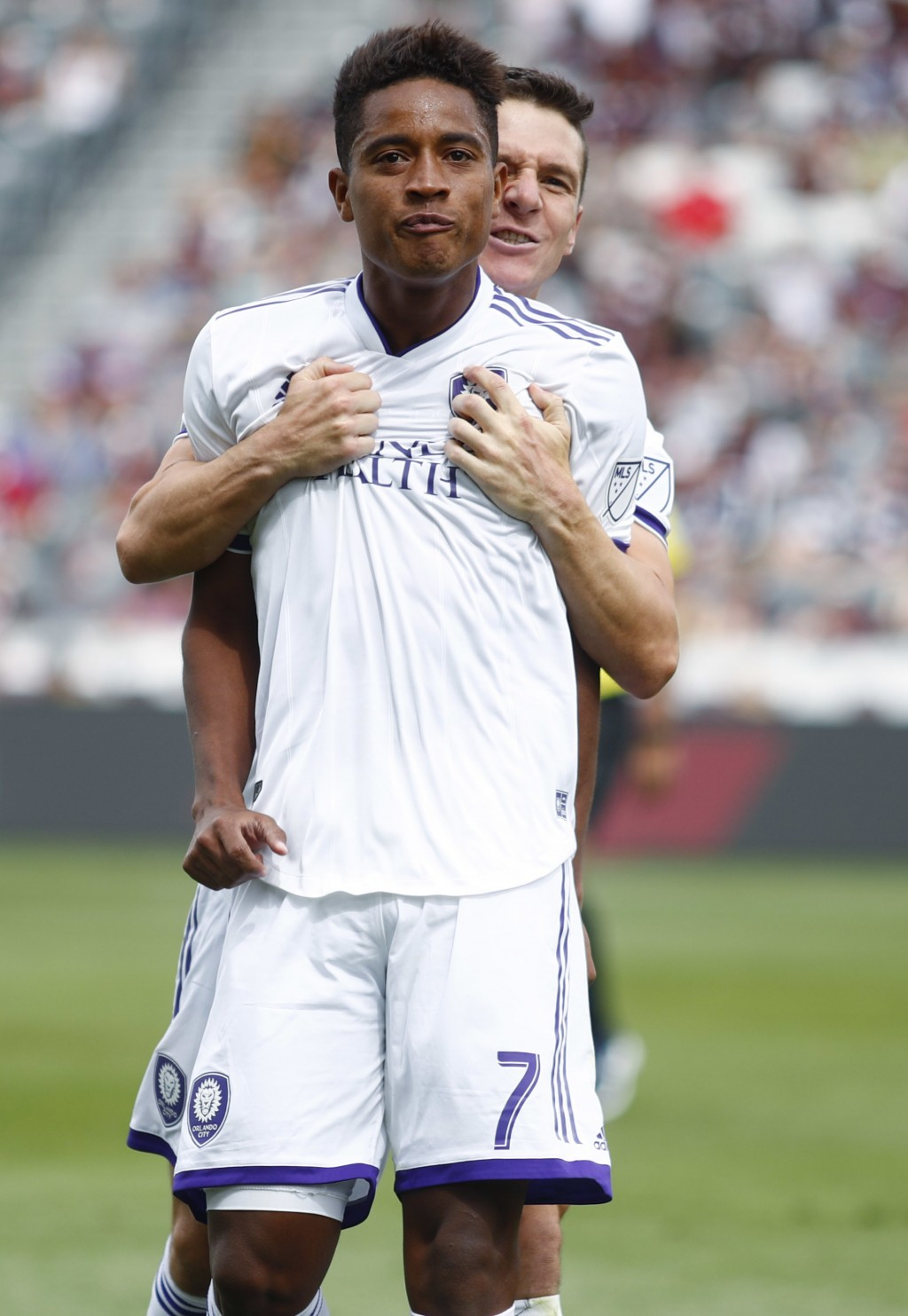 Orlando City midfielder Cristian Higuita, front, celebrates scoring the tying goal with midfielder Will Johnson in the second half of an MLS soccer ma...