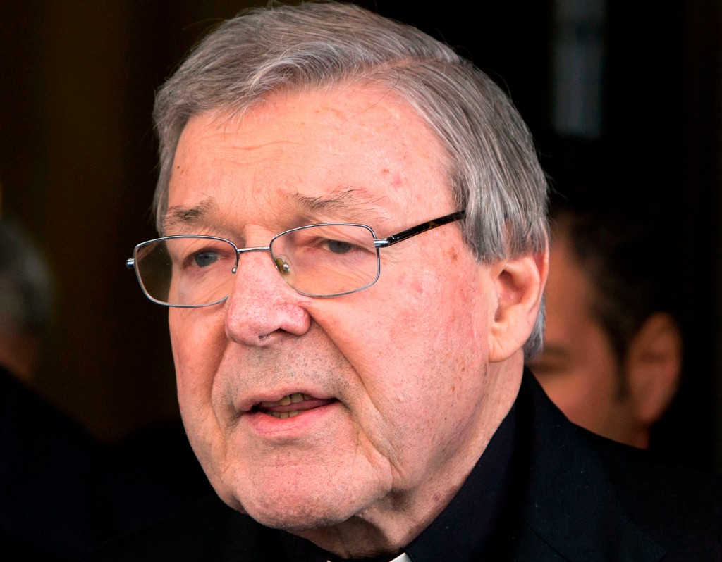 FILE - In this March 3, 2016, file photo, Australian cardinal George Pell reads a statement to reporters as he leaves the Quirinale hotel after meetin...