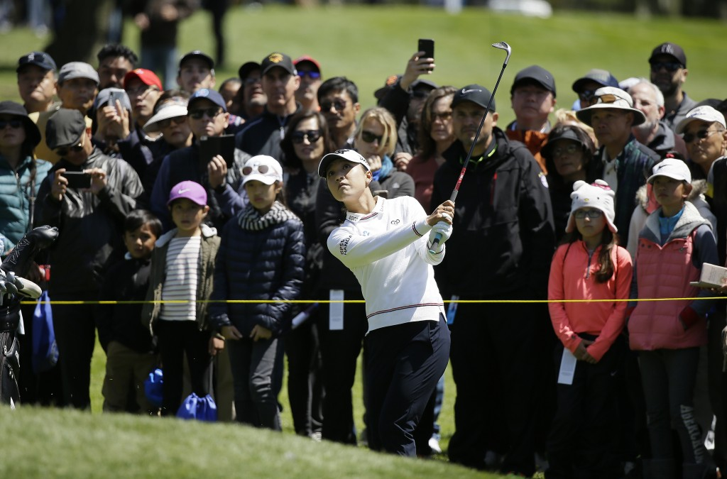 Lydia Ko, of New Zealand, follows her shot up to the first green of the Lake Merced Golf Club during the final round of the LPGA Mediheal Championship...
