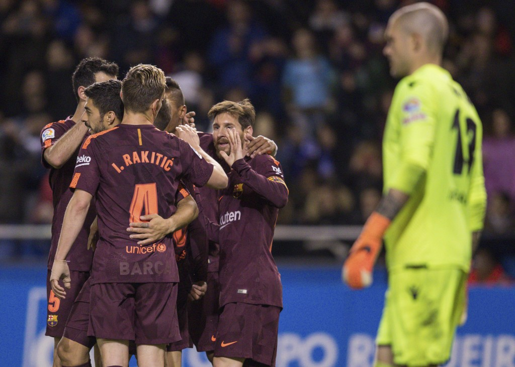 Barcelona's Lionel Messi, center, is congratulated by teammates after scoring a goal during a Spanish La Liga soccer match between Deportivo and Barce...