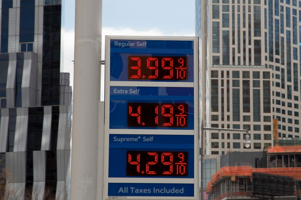 FILE- In this April 18, 2018, file photo, gas prices are displayed at a Mobil station in New York. Crude oil prices are at the highest level in more t...