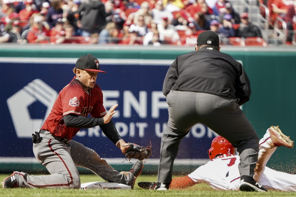 Washington Nationals' Trea Turner (7) steals second base during the seventh inning of a baseball game against the Arizona Diamondbacks at Nationals Pa...