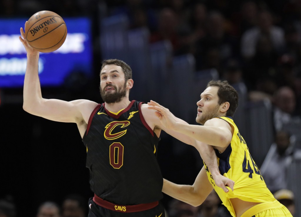 Cleveland Cavaliers' Kevin Love (0) grabs a rebound ahead of Indiana Pacers' Bojan Bogdanovic (44), from Croatia, in the second half of Game 7 of an N...