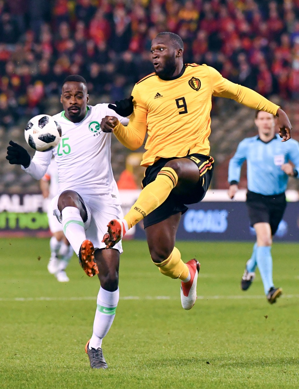 FILE - In this Tuesday, March 27, 2018 filer, Belgium's Romelu Lukaku, center, goes up against Saudi Arabia's Motaz Hawsawi during an international fr...