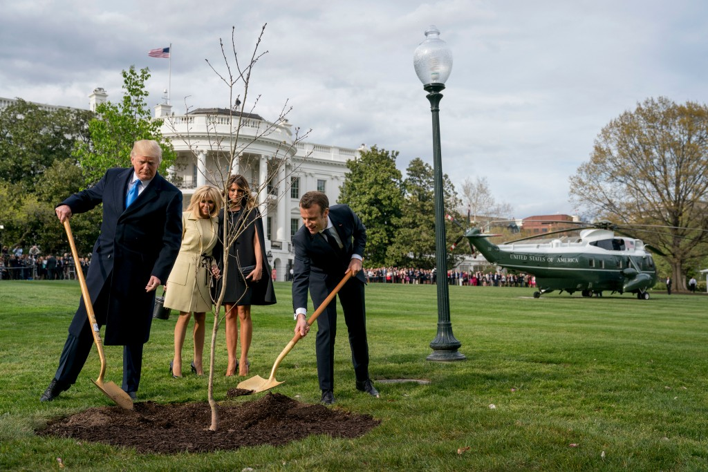 FILE- In this April 23, 2018, file photo, first lady Melania Trump, second from right, and Brigitte Macron, second from left, watch as President Donal...