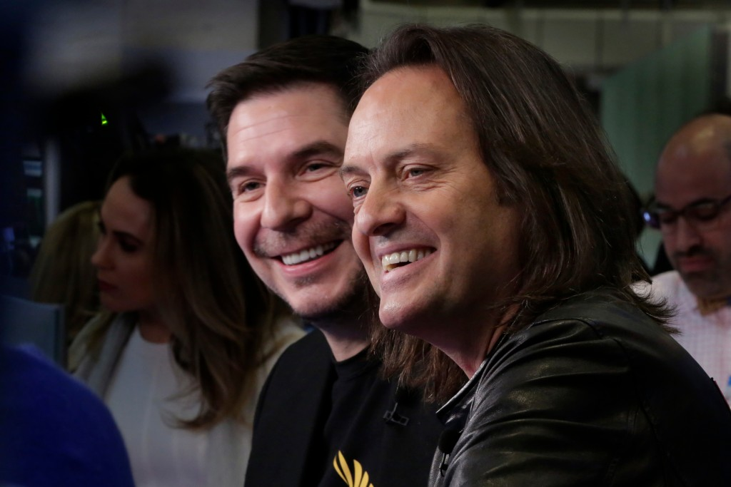 Sprint CEO Marcelo Claure, left, and T-Mobile CEO John Legere are interviewed on the floor of the New York Stock Exchange, Monday, April 30, 2018. To ...
