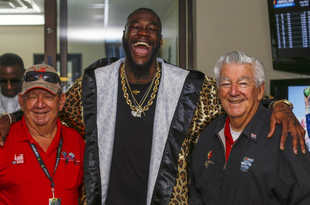 WBC Heavyweight Champion Deontay Wilder, center, poses with Donnie Allison, left, and Bobby Allison before the GEICO 500 NASCAR Talladega auto race at...