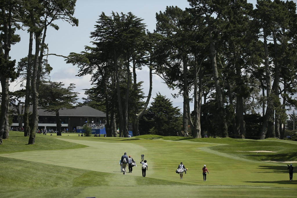 Minjee Lee, right, of Australia, walks up the fifth fairway of the Lake Merced Golf Club during the final round of the LPGA Mediheal Championship golf...