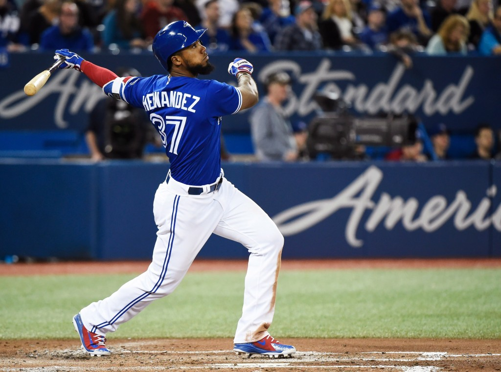 Toronto Blue Jays left fielder Teoscar Hernandez (37) hits a solo home run against the Texas Rangers during third inning baseball action in Toronto on...
