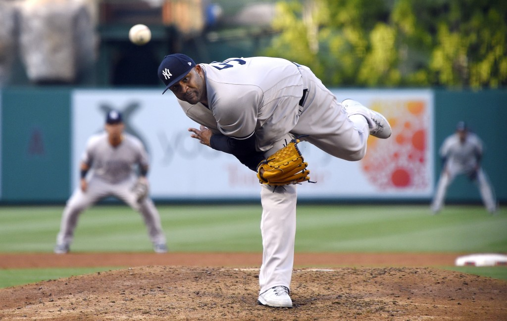 New York Yankees starting pitcher CC Sabathia throws to the plate during the fourth inning of a baseball game against the Los Angeles Angels, Sunday, ...