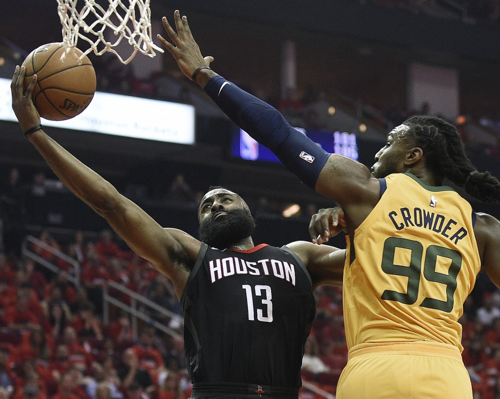 Houston Rockets guard James Harden (13) drives to the basket as Utah Jazz forward Jae Crowder defends during the first half in Game 1 of an NBA basket...