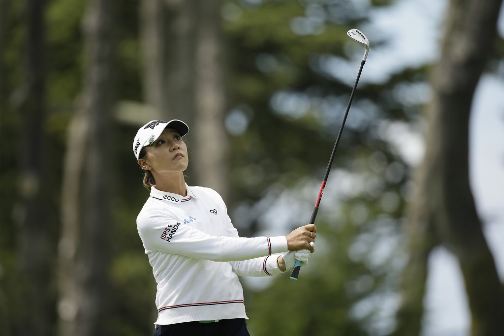 Lydia Ko, of New Zealand, follows her approach shot to the fifth green of the Lake Merced Golf Club during the final round of the LPGA Mediheal Champi...