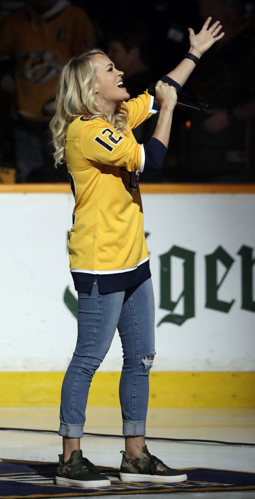 Carrie Underwood sings the national anthem before Game 2 of an NHL hockey second-round playoff series between the Nashville Predators and the Winnipeg...