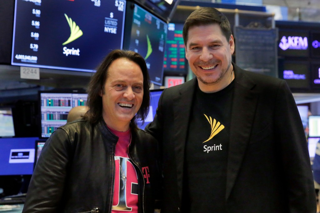 T-Mobile CEO John Legere, left, and Sprint CEO Marcelo Claure pose for photos on the floor of the New York Stock Exchange, Monday, April 30, 2018. To ...