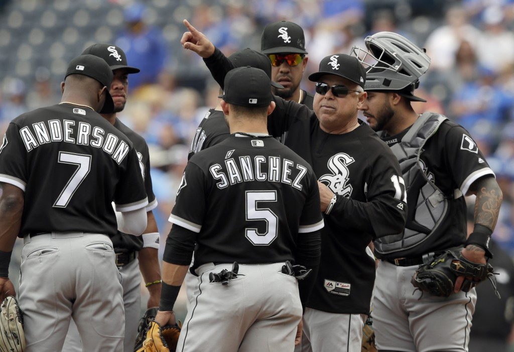 Chicago White Sox manager Rick Renteria (17) calls for new pitcher during the fifth inning of a baseball game against the Kansas City Royals at Kauffm...
